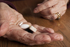 Aging and Health Care - hands and pills. Aging and Health Care  hands and pills Royalty Free Stock Photo