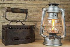 Aging oil Lamp and flatiron Royalty Free Stock Photos