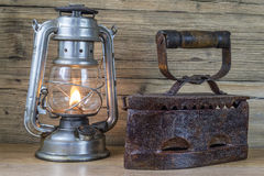 Aging oil Lamp and flatiron Royalty Free Stock Image