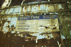 Aging and peeling fare sign. Torn aging fare sign on exterior of peeling trolley car Royalty Free Stock Photo