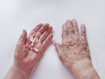 Aging and pills Royalty Free Stock Photography