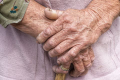 Aging process -old senior woman hands wrinkled skin Stock Images