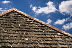 Aging Roof. Roof top of old building. Beautiful blue sky royalty free stock photos
