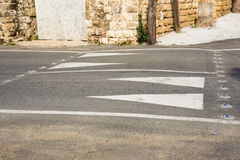 Arrow road markings and concrete road barrier Royalty Free Stock Image