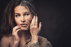 Aging, skin care concept. Half old half young woman. Aging and skin care concept. Half old half young woman royalty free stock photography