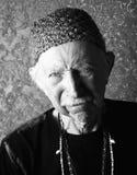 Aging Tough Guy. Senior tough guy in green knit cap leaning Royalty Free Stock Photo