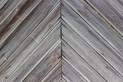 Aging wall of the wooden building as background or texture. Stock Photos
