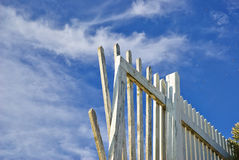 Aging white wooden fence Stock Photo
