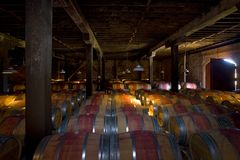 Aging Wine. Wine barrels aging fine wine in a historic building near Napa, CA Royalty Free Stock Photos