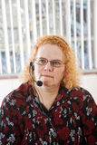 Aging Workforce. Productive middle aged woman working in a call center Stock Images