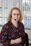 Aging Workforce. Productive middle aged woman working in a call center Stock Photo