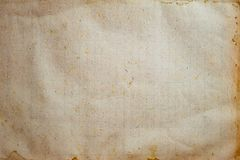 Aging, worn paper with water stains and rough edges. Top view royalty free stock photos