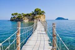 Bridge to the small island Cameo, Zakynthos, Greece. Agio Sostis, Greece - July 22, 2017: Tourists on the wooden bridge to the island Cameo, Zakynthos, Greece stock images