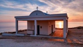 Agioi Anargyroi church. Cyprus, Mediterranean Sea coast. Agioi Anargyroi church at Cape Greco at sunrise Stock Images