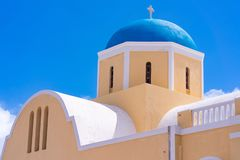 Agios Georgios Church with blue dome in Oia. Santorini island, Greece stock images