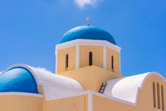 Agios Georgios Church with blue dome in Oia. Santorini island, Greece royalty free stock photo