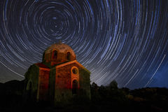 Agios Ioannis Prodromos Church, a ruin of a church at Sounio in. A circular Star Trail of the North Star over the ruins of the church ` Agios Ioannis Prodromos` stock image