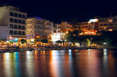 Agios Nikolaos. CRETE, GREECE - JULY 5: Night view of Lake Voulismeni on July 5, 2010 in Agios Nicolaos. Small lagoon Lake Voulismeni located in center of  and Stock Images