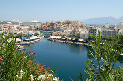 Agios Nikolaos, Crete. The picturesque town of Agios Nikolaos in Crete, Greece with a cruise liner in the harbour Royalty Free Stock Images
