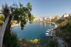 Agios Nikolaos. Crete, Greece. View on the lake and docked yachts. Aegean bay town aghios island architecture beach voulismeni blue port building coast eastern royalty free stock image