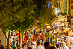 AGIOS NIKOLAOS, CRETE - JULY 28, 2012: Hundreds of tourists on t. He main pedestrian street with shops and restaurants on Crete by night Royalty Free Stock Photo