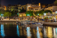 AGIOS NIKOLAOS, CRETE - JULY 26, 2012: Tourists relax in outdoor Stock Photography