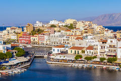 AGIOS NIKOLAOS, GREECE - AUGUST 1, 2012: Tourists walking in cit Royalty Free Stock Photography