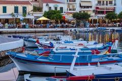 AGIOS NIKOLAOS, GREECE - JULY 24, 2012: Tourists eating in resta. Urants near Voulismeni Lake at Night Stock Photography