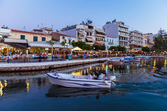 AGIOS NIKOLAOS, GREECE - JULY 24, 2012: Tourists eating in resta Stock Images