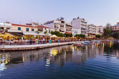 AGIOS NIKOLAOS, GREECE - JULY 24, 2012: Tourists eating in resta Royalty Free Stock Photos