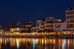 AGIOS NIKOLAOS, GREECE - JULY 27, 2012: Tourists eating in resta Royalty Free Stock Images