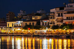 AGIOS NIKOLAOS, GREECE - JULY 27, 2012: Tourists eating in resta Royalty Free Stock Photo