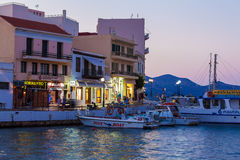 AGIOS NIKOLAOS, GREECE - JULY 28, 2012: Tourists walking in city. Center after sunset Royalty Free Stock Image