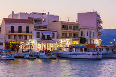 AGIOS NIKOLAOS, GREECE - JULY 28, 2012: Tourists walking in city Stock Photo