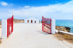 Agios Nikolaos. Open gate and white church. Agios Nikolaos. Open red gate and white Orthodox church on the Sea. Coast of island Zakynthos, Greece stock photography