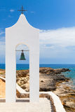Agios Nikolaos. Small white Orthodox bell tower Royalty Free Stock Photography
