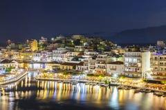 Agios Nikolaos town at summer night. Agios Nikolaos, Crete, Greece - June 08, 2017: Agios Nikolaos town at summer night. Agios Nikolaos is one of the most Stock Photo