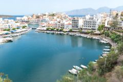 Agios Nikolaos and Voulismeni lake in Crete island. Greece. Tilt-shift effect Royalty Free Stock Photo