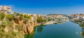 Agios Nikolaos with the Voulismeni Lake. View to the Limni Voulismeni Lake and the waterfront of the fishing village Agios Nikolaos Royalty Free Stock Photos