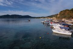 Agios Sostis, Zakynthos Island, Greece – September 24, 2017: Boats in Laganas harbor on a summer cloudy day. Agios Sostis, Zakynthos Island, Greece royalty free stock photography