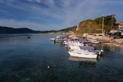 Agios Sostis, Zakynthos Island, Greece – September 24, 2017: Boats in Laganas harbor on a summer cloudy day. Agios Sostis, Zakynthos Island, Greece royalty free stock image