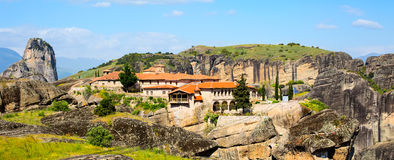 Agios Stefanos St Stefan Monastery on Meteora cliff, Greece. Panoramic view of Agios Stefanos St Stefan Monastery Meteora monastery on the high cliff rock Royalty Free Stock Photos