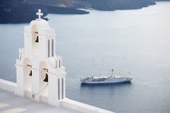Agios Theodori belltower with cruise ship in background, Santorini island Royalty Free Stock Photo