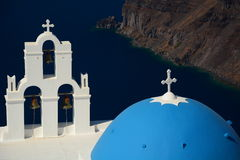 Agios Theodori church, bellstower and dome. Firostefani, Santorini, Cyclades islands. Greece. Santorini  is an island in the southern Aegean Sea. It forms the Royalty Free Stock Images