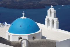 Agiou Mina Church Thira Santorini. The blue dome and bell tower of the Agiou Mina Church, high above the sea at Fira Town, Santorini Thira, Cyclades Islands Royalty Free Stock Photography