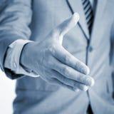 Agitação da mão da oferta do homem de negócios Fotos de Stock