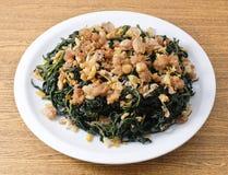 Agitação Fried Jute Leaves do chinês com carne de porco triturada fotografia de stock