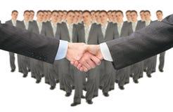 Agitando as mãos e a colagem do grupo do grande negócio foto de stock