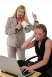 Agitated Business Team. Extreme two person business team with one worker shouting commands through a megaphone Royalty Free Stock Photography