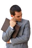 Agitated businessman. Thinking and holding a document Stock Image